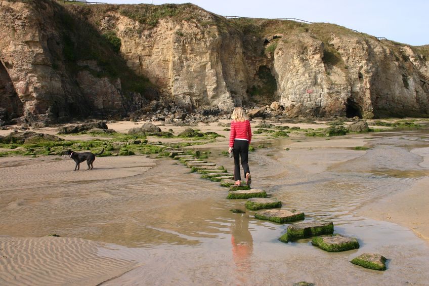 Exercise walking on beach stepping stones