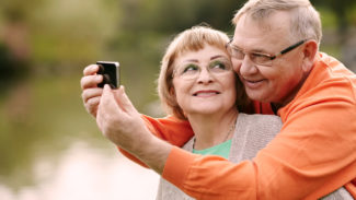 Couple taking selfie to raise awareness of legacy fundraising