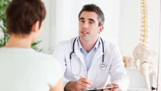 Health Professional Doctor with patient in consultation