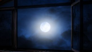 View of the moon through a window