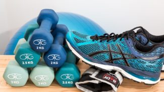 Trainers next to a stack of dumbbells