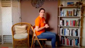 Zoë Clark sat on a chair