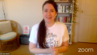 Photo of Zoë Clark in a Christmas top while talking about self care