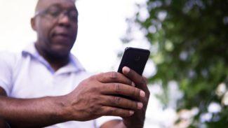 man reading mobile phone
