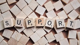 Scrabble tiles spelling the word support