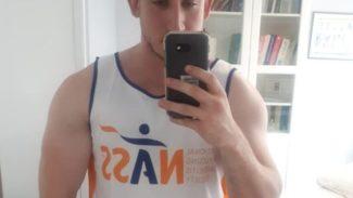 Selfie of Andrew wearing a NASS vest top
