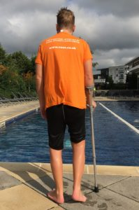 Swimming with axial SpA. Darren standing by the pool